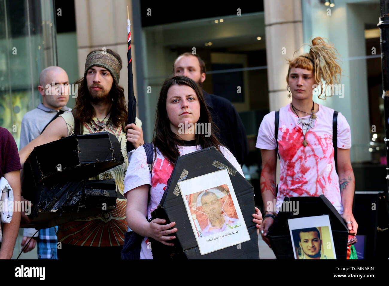 Manchester, UK. 15th May 2018. Pro Palestinian campaigners entered HSBC Bank, laying coffins and fake bank notes on the floor to protest at Òthe banks deals with arms companies and calling for banks to divest from companies that sell weapons to Israel'.  Police were called to the bank and the protesters moved outside, St Anns Square, Manchester,15th May, 2018 (C)Barbara Cook/Alamy Live News - Stock Image