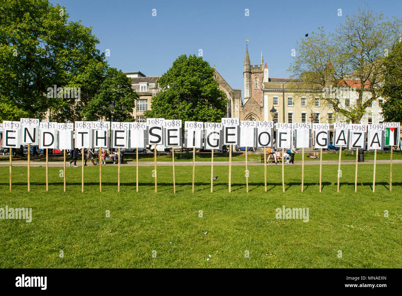 Bristol, UK. 15th May, 2018. An Art installation made up of seventy placards - one for every year since the start of the war was unveiled  outside City Hall ahead of a Pro-Palestinian protest march through Bristol. The Pro-Palestinian protest march was held to allow people to show their support and solidarity with the Palestinian people after 70 Years of Nakba and to protest about Israel's recent actions in Gaza. Credit: lynchpics/Alamy Live News - Stock Image