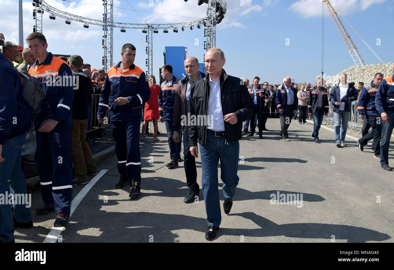 Russian President Vladimir Putin during the opening ceremony for the Crimean Bridge motorway May 15, 2018 in Taman, Kerch, Russia. Putin drove the lead vehicle in a construction equipment convoy marking the inauguration of the project linking Russia with Crimea.    (Russian Presidency via Planetpix) - Stock Image