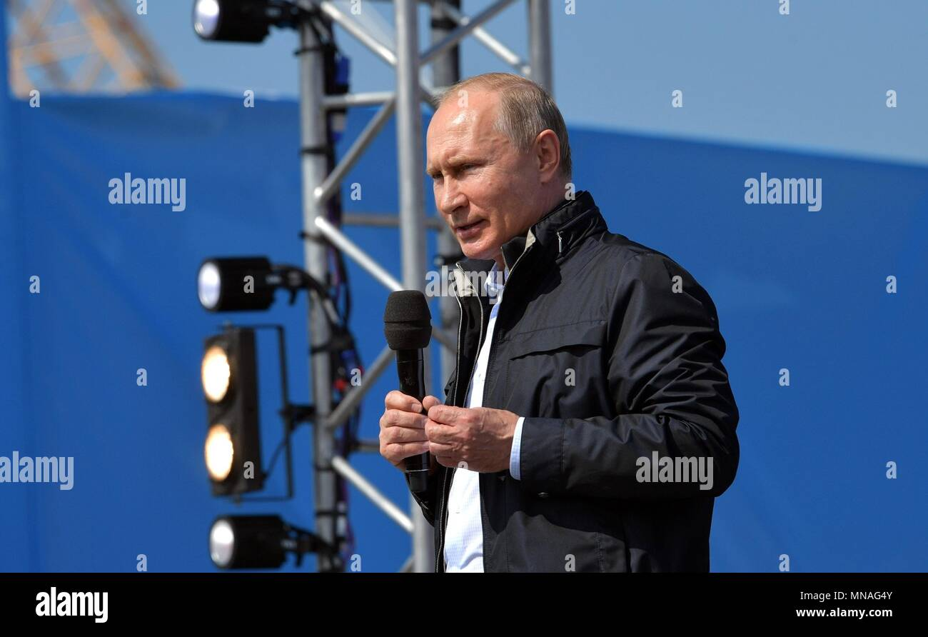 Russian President Vladimir Putin addresses workers and officials during the opening ceremony for the Crimean Bridge motorway May 15, 2018 in Taman, Kerch, Russia. Putin drove the lead vehicle in a construction equipment convoy marking the inauguration of the project linking Russia with Crimea.    (Russian Presidency via Planetpix) - Stock Image