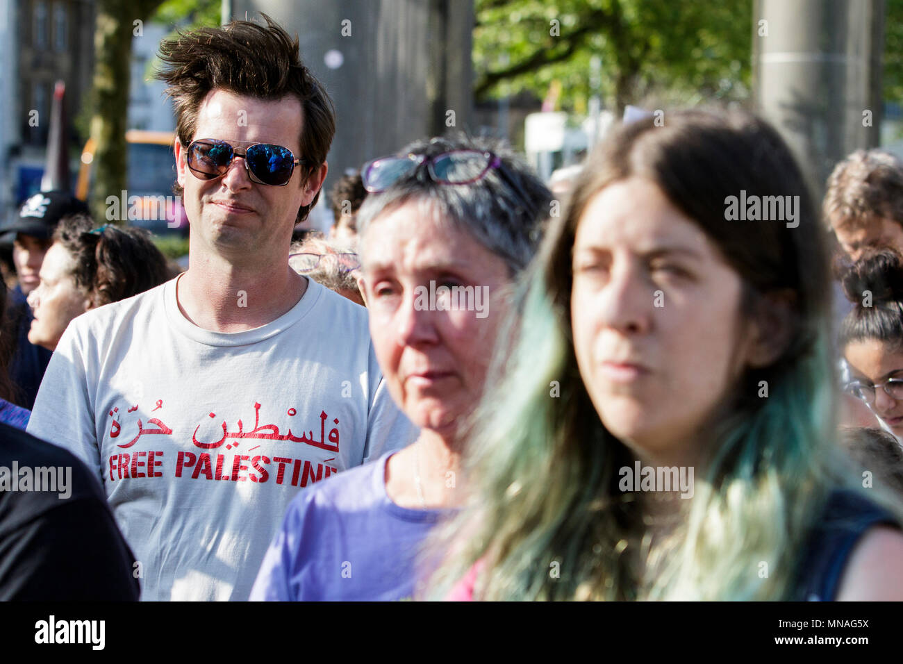 Bristol, UK. 15th May, 2018. Pro-Palestinian demonstrators are pictured as they listen to speeches ahead of a Pro-Palestinian protest march through Bristol. The protest march and rally was held so as to allow people to show their support and solidarity with the Palestinian people after 70 Years of Nakba and to protest about Israel's recent actions in Gaza - Stock Image