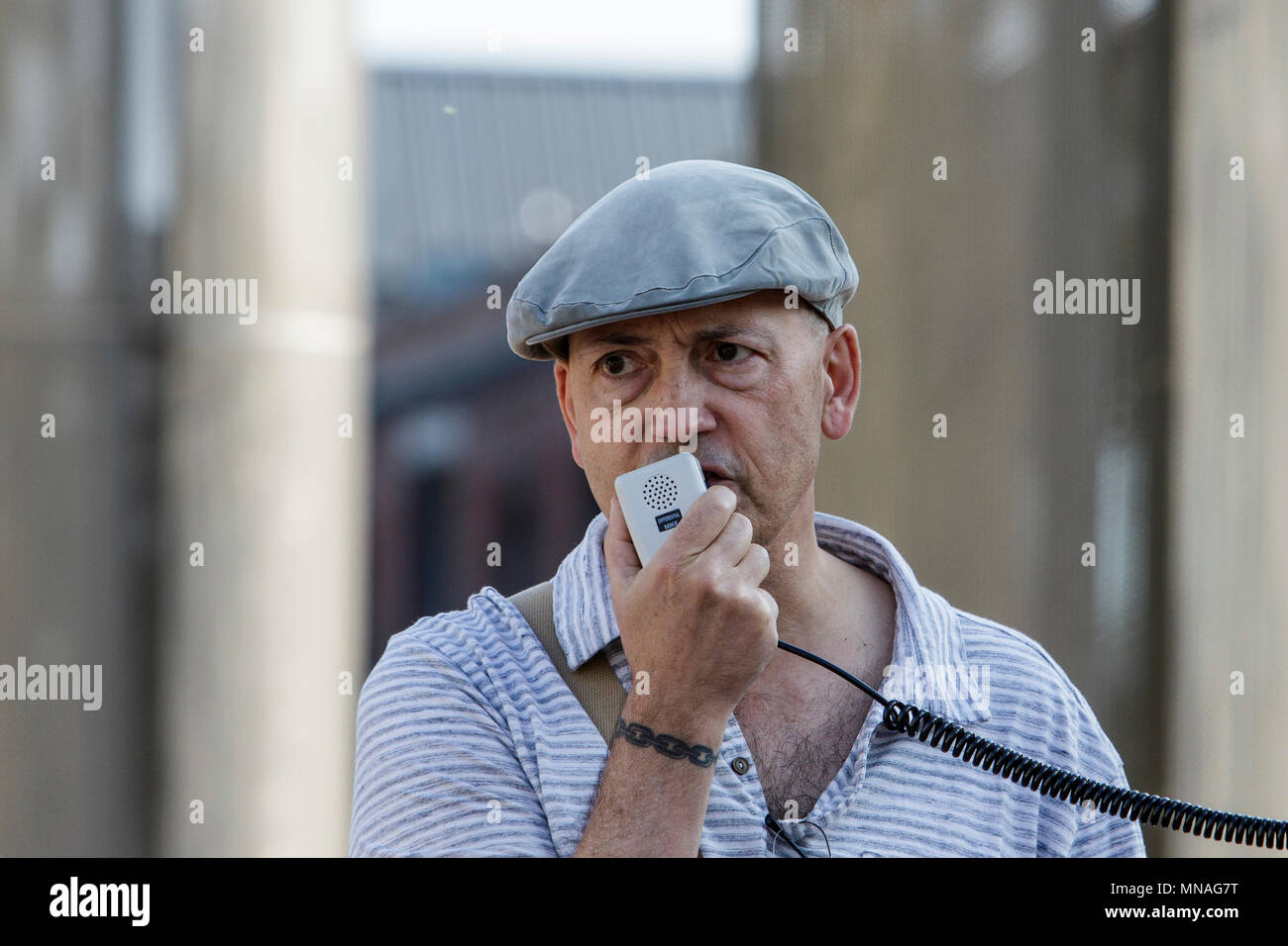 Bristol, UK. 15th May, 2018. A speaker representing the Jewish Voice For Labour is pictured as he speaks to the crowd ahead of a Pro-Palestinian protest march through Bristol. The protest march and rally was held to allow people to show their support and solidarity with the Palestinian people after 70 Years of Nakba and to protest about Israel's recent actions in Gaza. - Stock Image