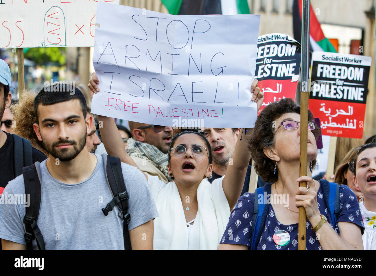 Bristol, UK. 15th May, 2018. Pro-Palestinian demonstrators holding placards and waving Palestinian flags are pictured as they march through Bristol in a protest march to show their solidarity with the Palestinian people. The protest march and rally was held to allow people to show their support and solidarity with the Palestinian people after 70 Years of Nakba and to protest about Israel's recent actions in Gaza - Stock Image
