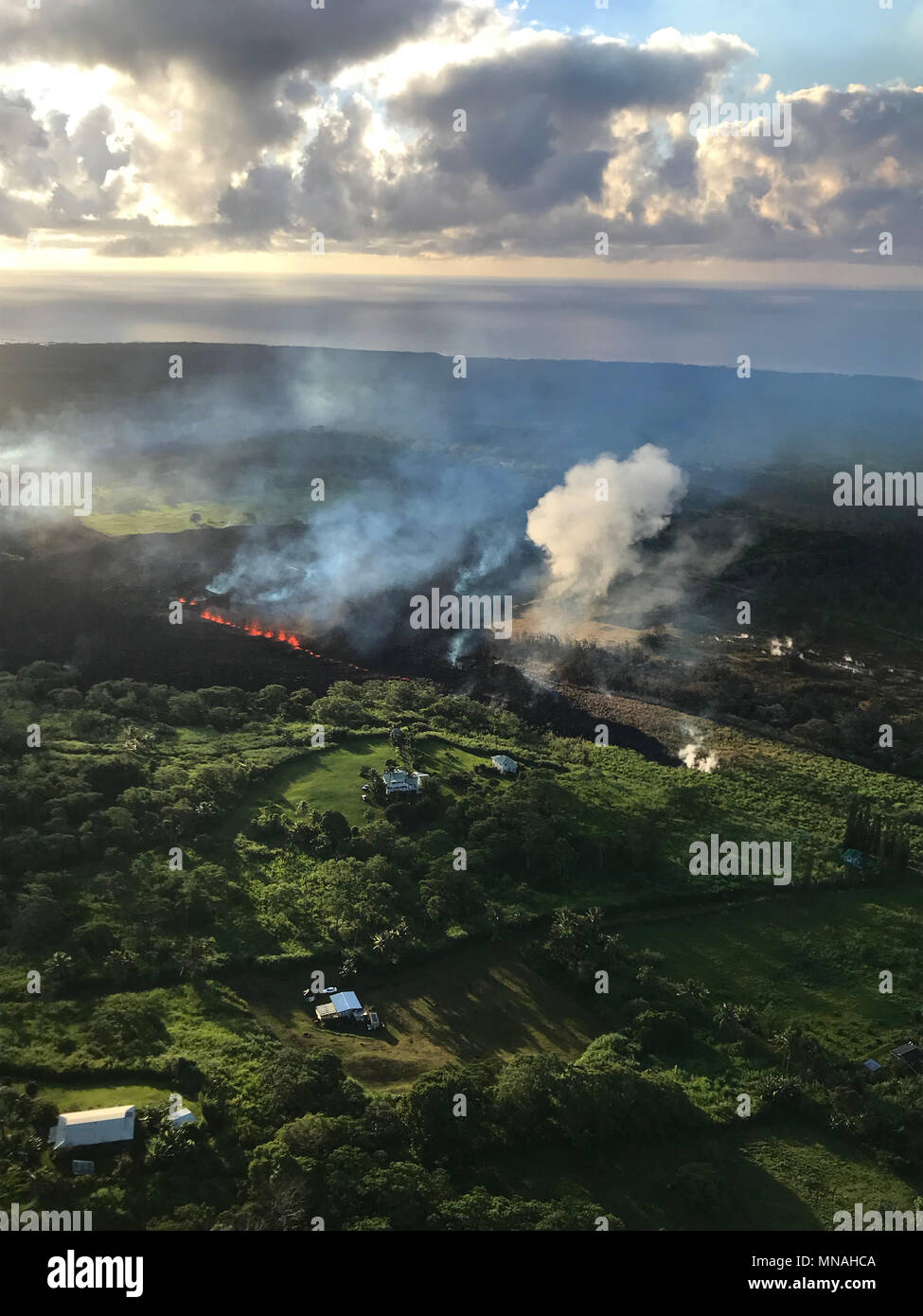 Kilauea Volcano, Hawaii. 15th may 2018. An early morning view of fissure 17 from the Kilauea volcano May 15, 2018 in Hawaii. The recent eruption continues destroying homes, forcing evacuations and spewing lava and poison gas on the Big Island of Hawaii. Credit: Planetpix/Alamy Live News Stock Photo