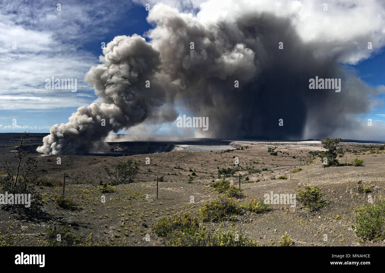 Kilauea Volcano, Hawaii. 15th may 2018. A grey ash plume rises from the Halemaumau crater in the Kilauea volcano May 15, 2018 in Hawaii. The recent eruption continues destroying homes, forcing evacuations and spewing lava and poison gas on the Big Island of Hawaii. Credit: Planetpix/Alamy Live News Stock Photo