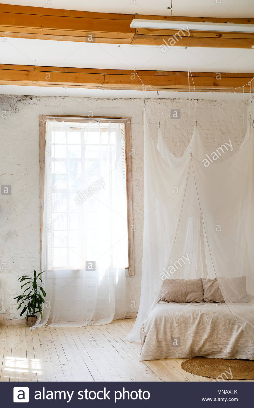 Bedroom In Soft Light Colors With A Wooden Floor Stock Photo