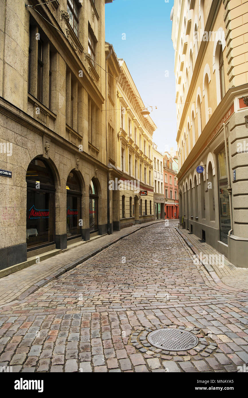 Riga, Latvia. Maza Smilsu iela street in Riga. Narrow medieval cobbled street in the old town in Riga with tenement houses. - Stock Image