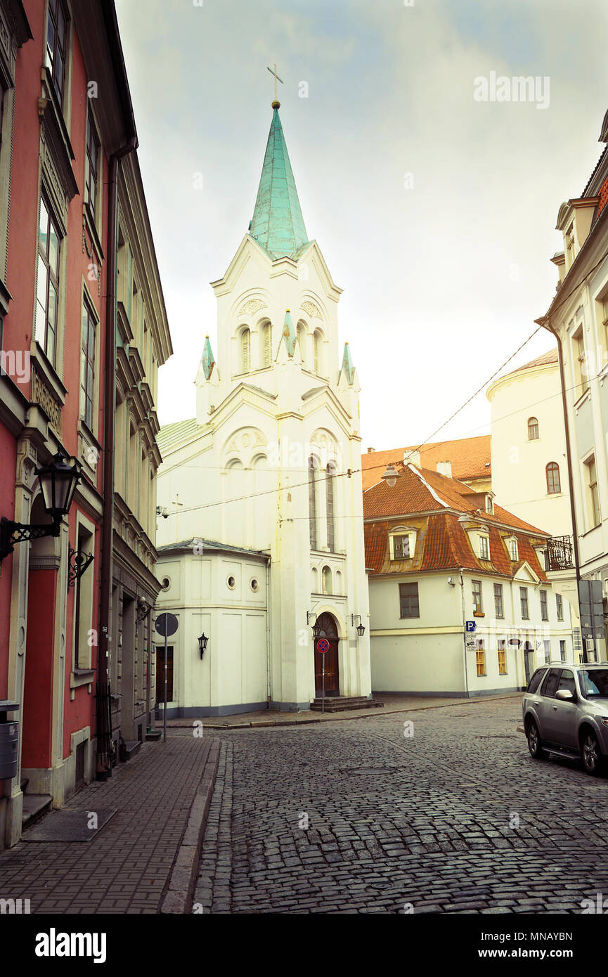 Riga, Latvia. Our Lady of Sorrows Church in Riga. Roman Catholic church built in 1785 is located on Pils iela street. Retro vintage style. - Stock Image