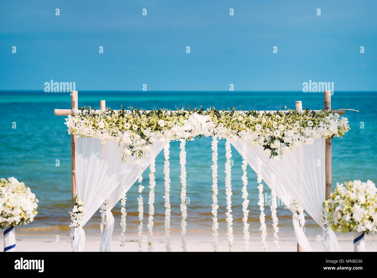 The Beautiful Wedding Venue Setting With White And Green Flowers