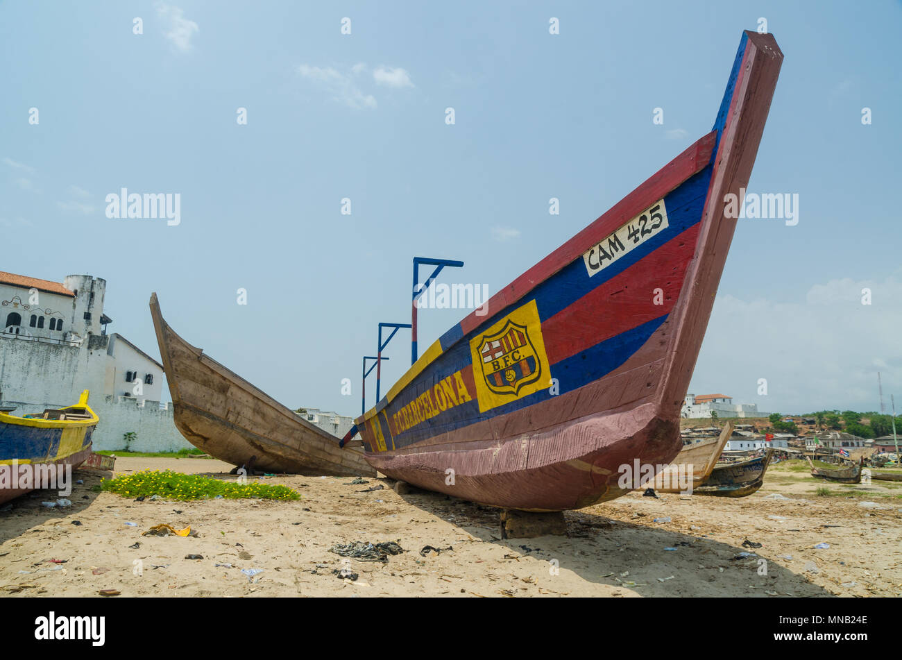 Wooden fishing boat on beach painted with FC Barcelona football club colours - Stock Image