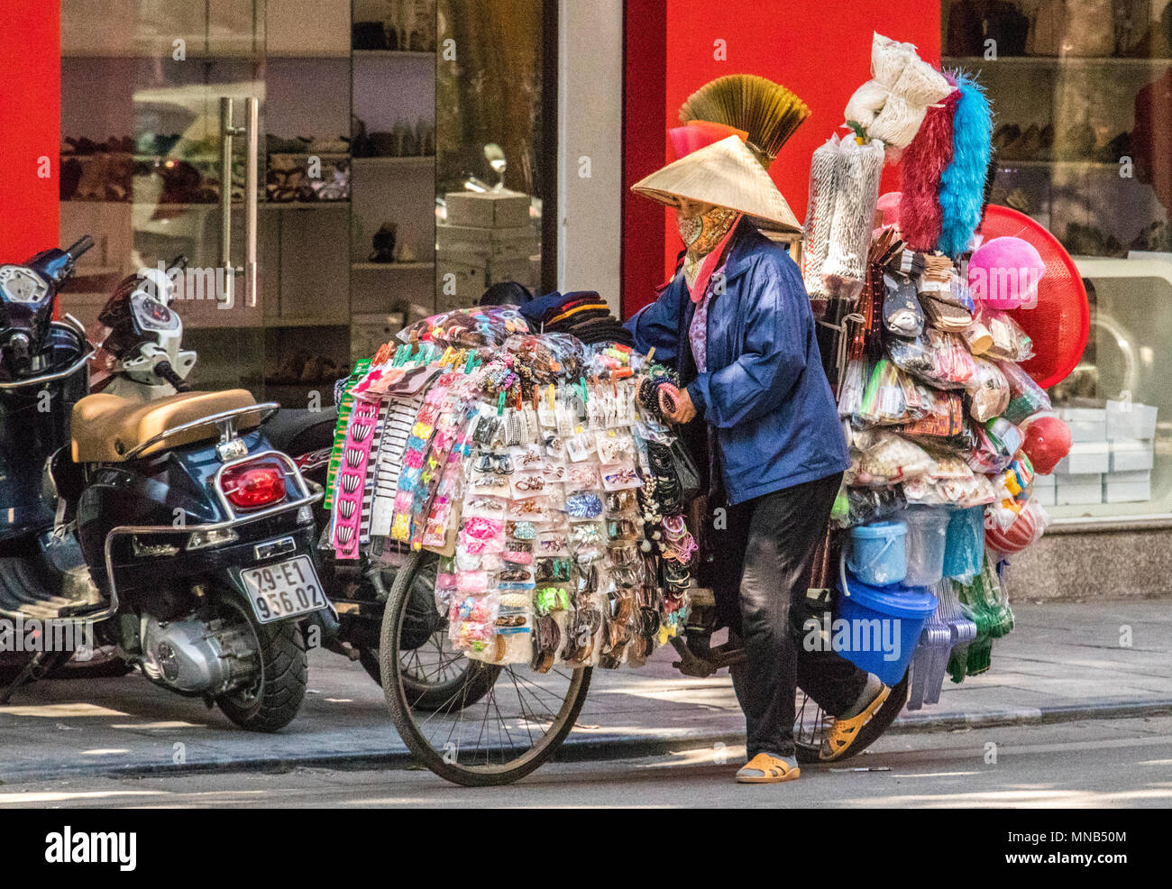Life and work of vendors and shopkeepers on streets of Hanoi Vietnam