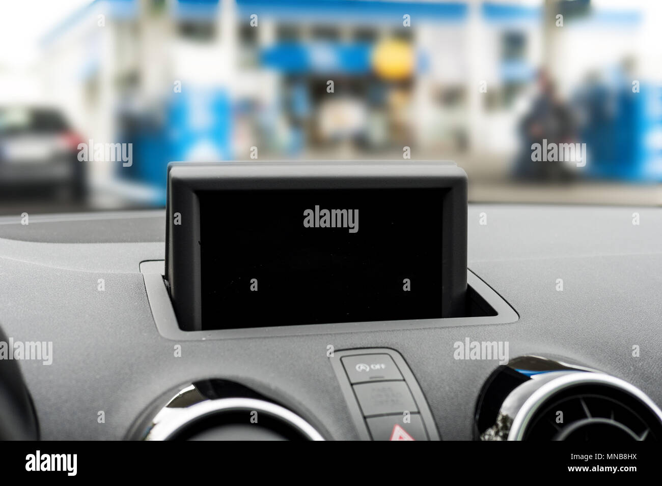 Car GPS on dashboard. Screen off. Selective focus. - Stock Image