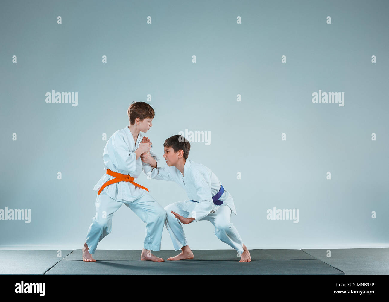 68cab297adb3b The two boys fighting at Aikido training in martial arts school. Healthy  lifestyle and sports concept