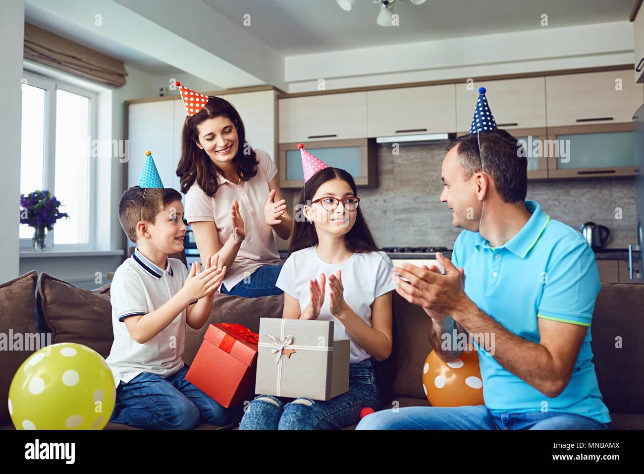 Happy family with cake on birthday party Stock Photo