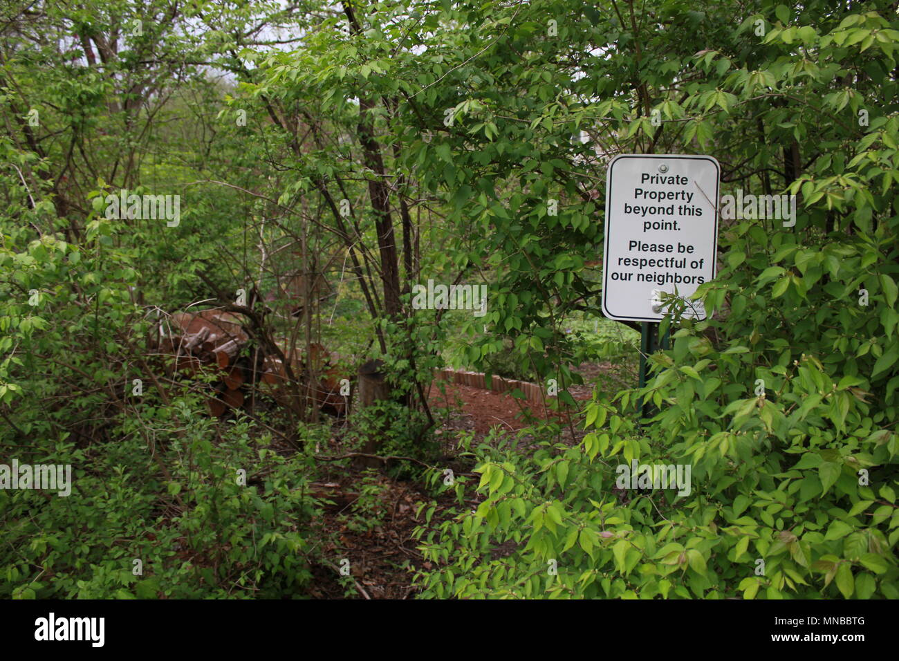 Warning sign asking people to be respectful of neighbors and designating private property lines. - Stock Image