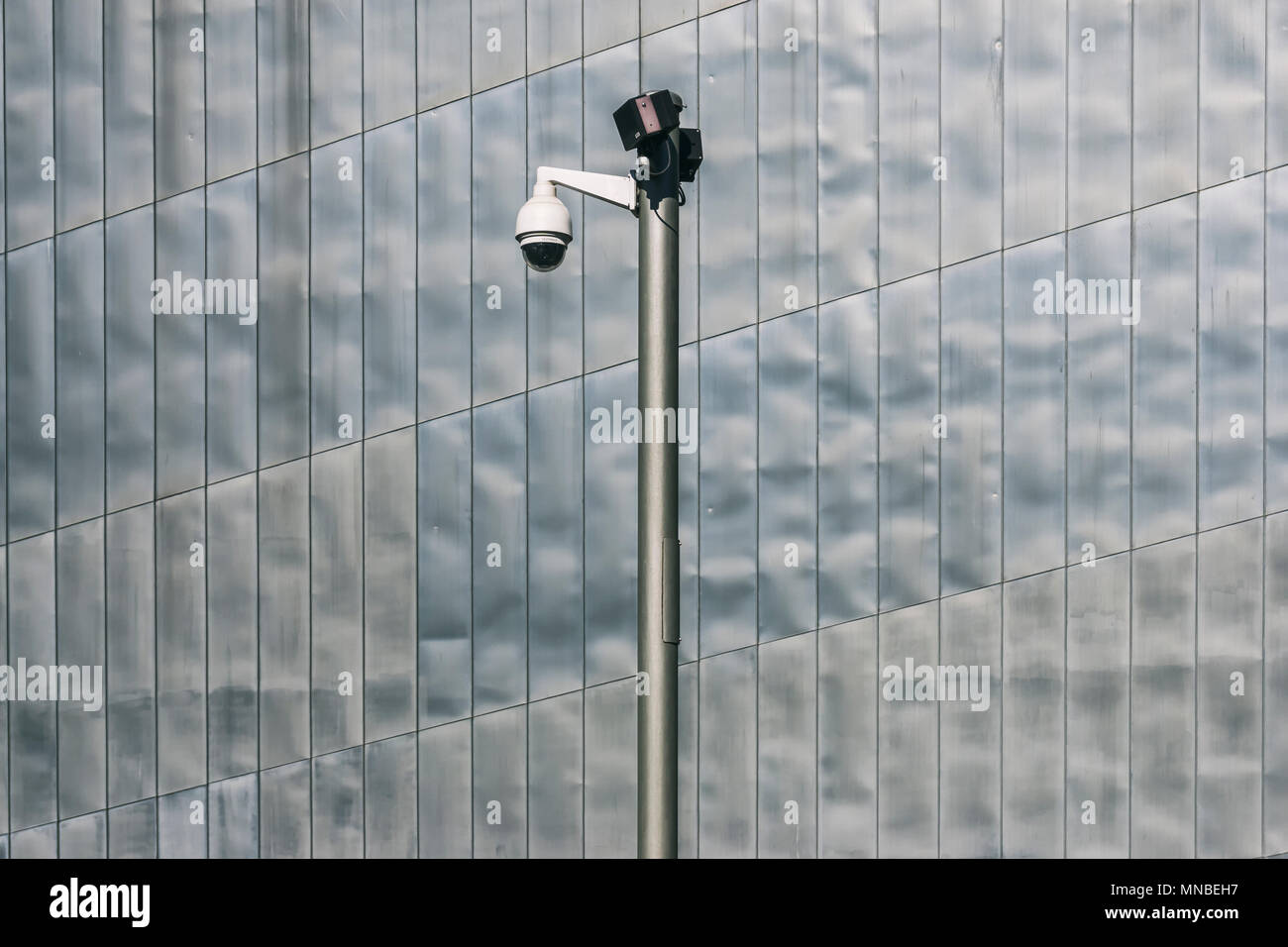Berlin, Germany, April 06, 2018: Surveillance camera against modern metal facade at Jewish Museum - Stock Image