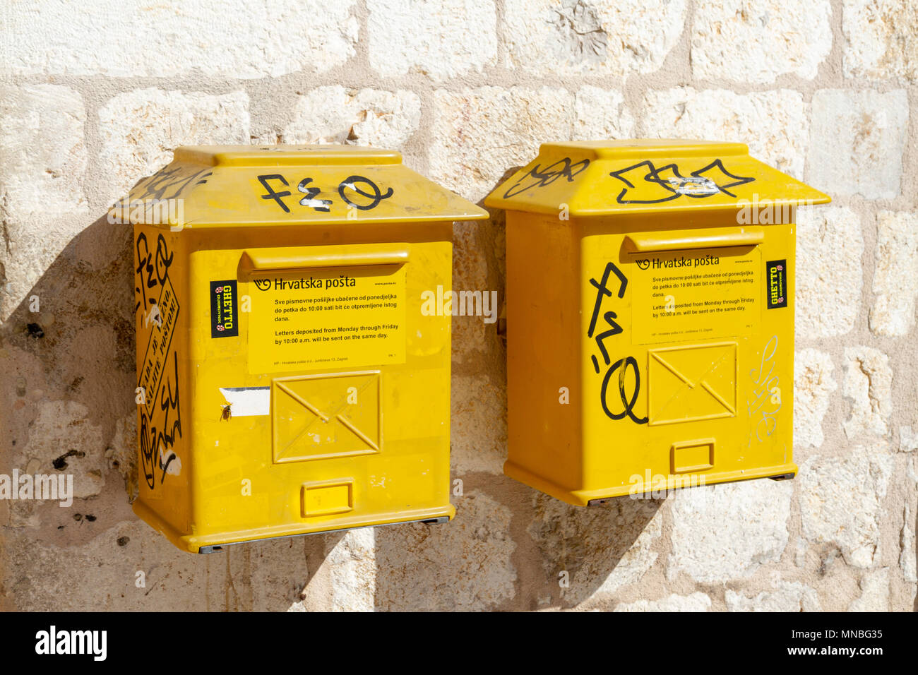 A pair of Hrvatska Pošta (Croatian post Office) boxes on a wall in the Old City, Dubrovnik, Croatia. - Stock Image