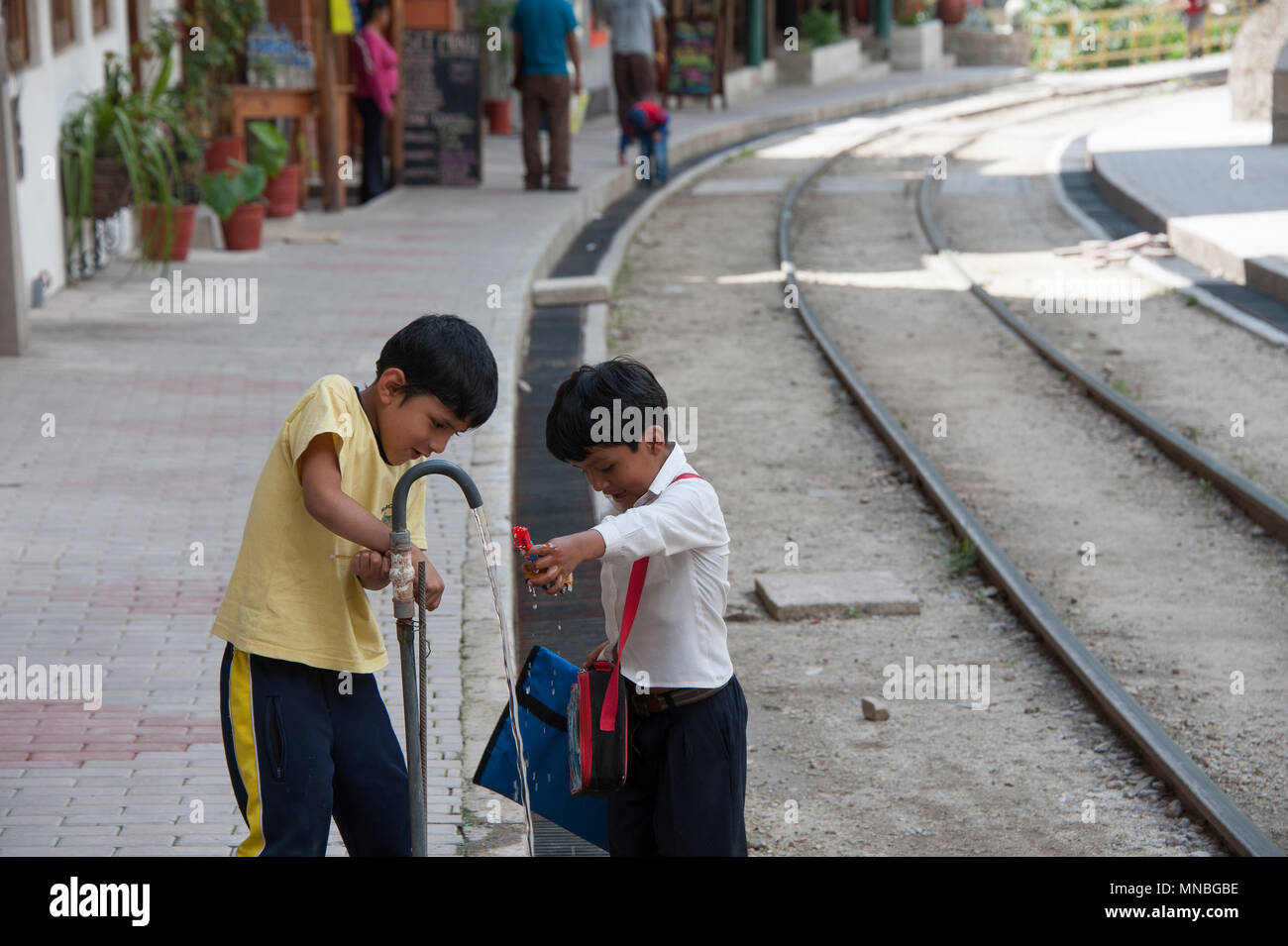Children playing in danger near the railway track at Aguas Calientes. district of Machu Picchu. Stock Photo