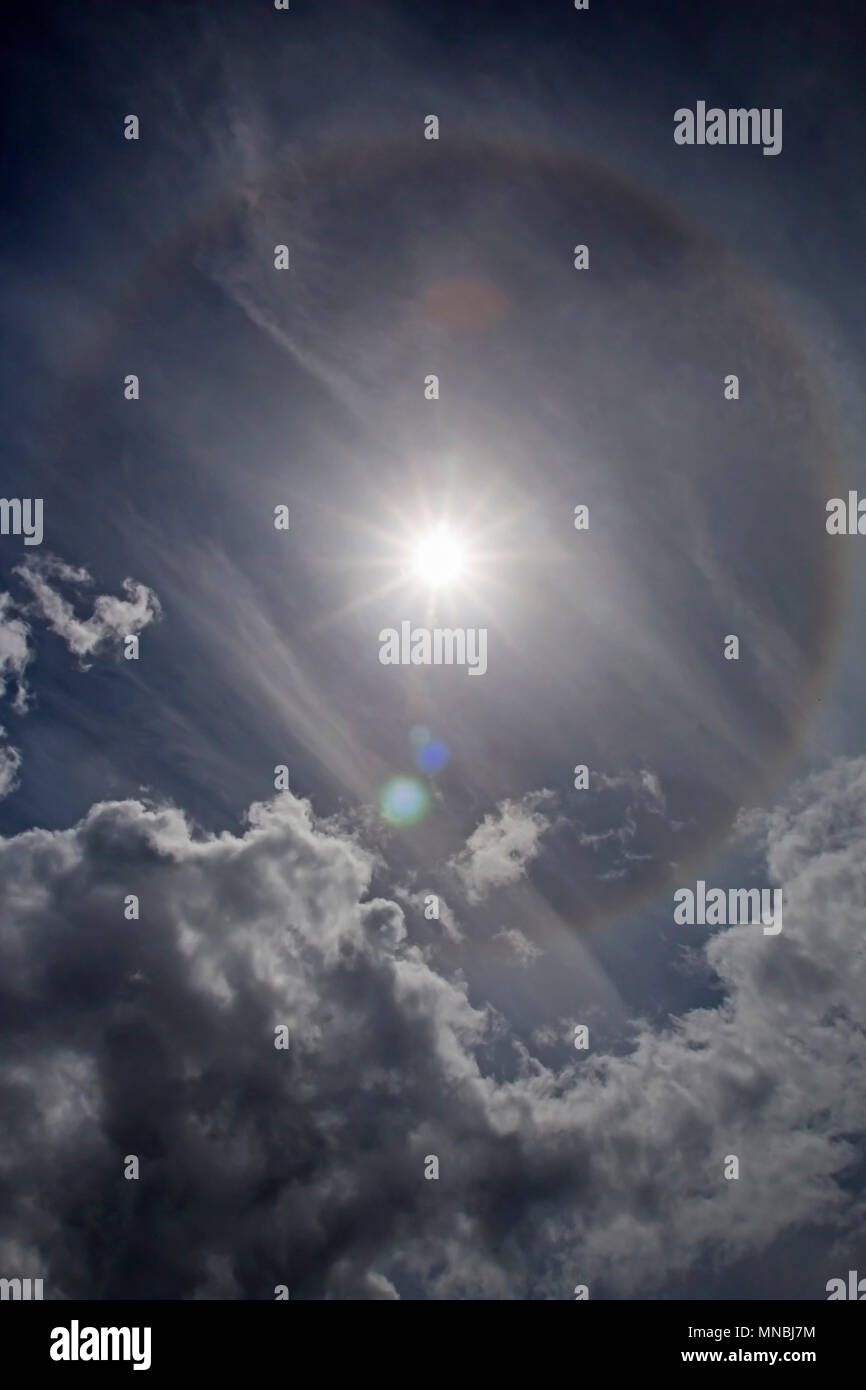 Halos are atmospheric phenomena created by light which is reflected or refracted by ice crystals in the atmosphere. - Stock Image
