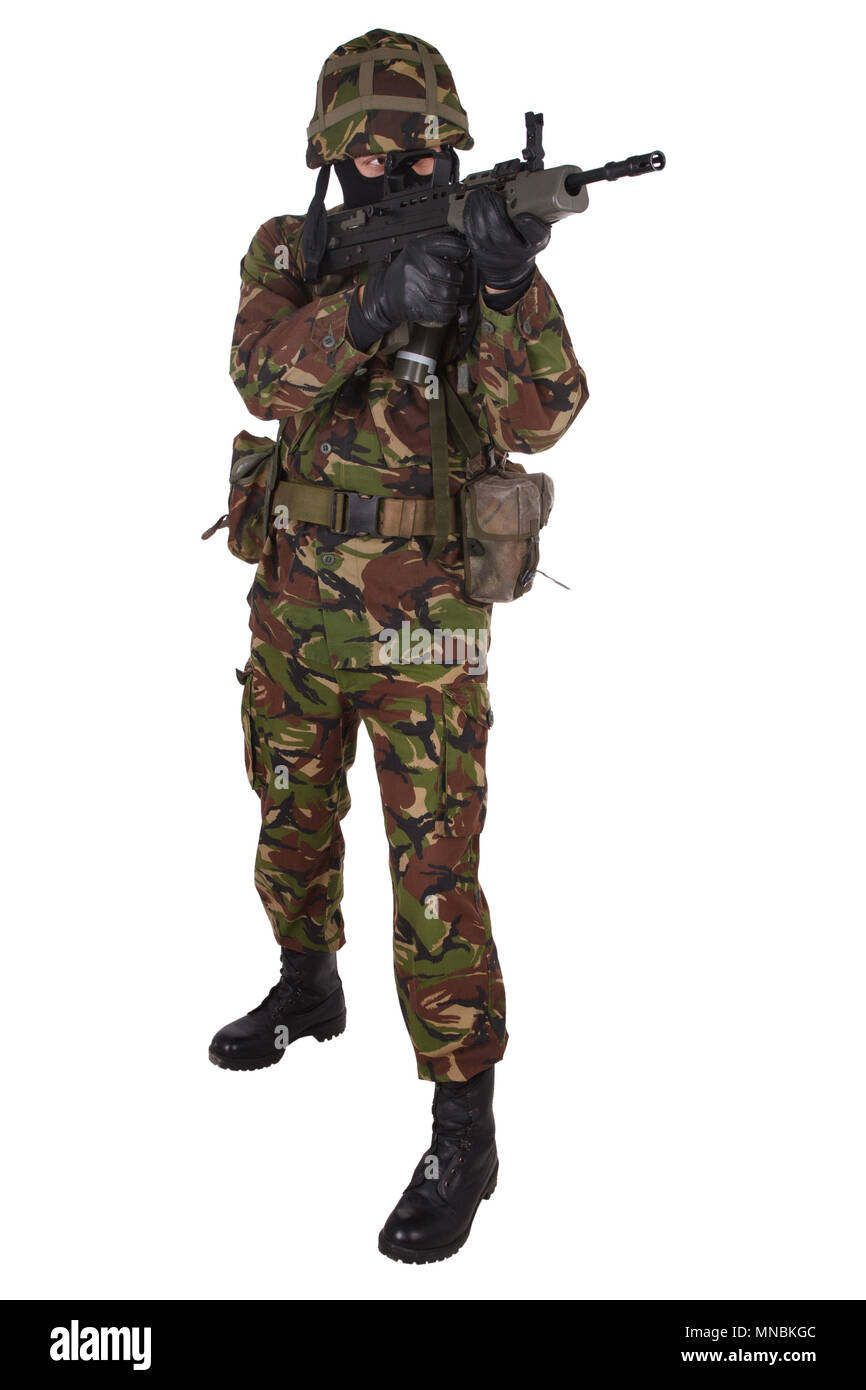 British Army Soldier in camouflage uniforms isolated on white - Stock Image