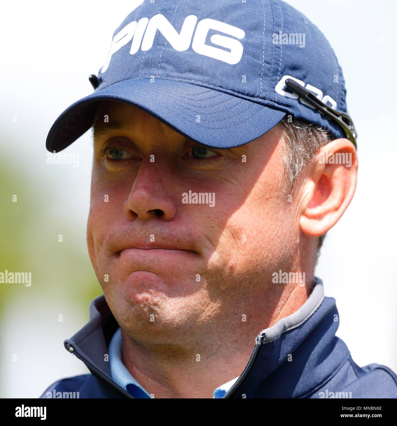 Lee Westwood on the finishes par for the course on the 18th green during the first round of the BMW PGA Championship European tour at Wentworth Golf Club. 21 May 2015 - Stock Image