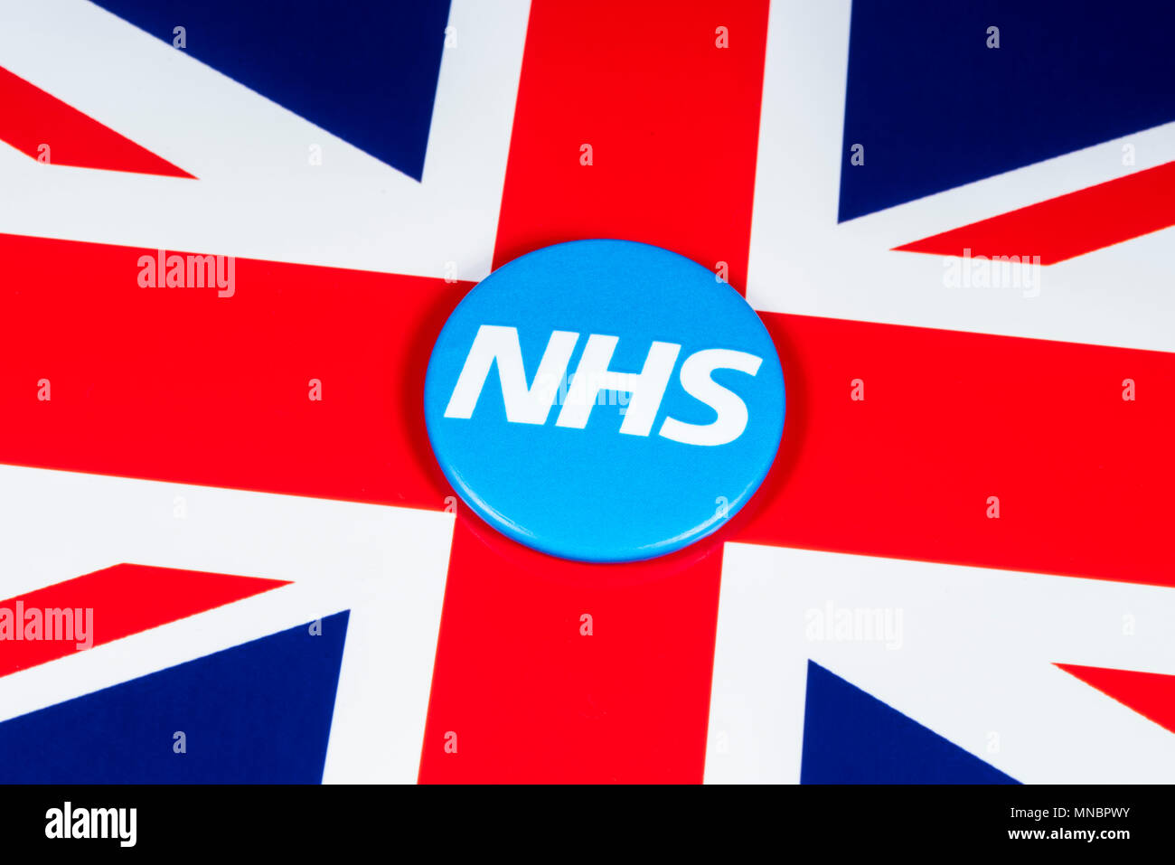 LONDON, UK - APRIL 27TH 2018: The National Health Service symbol over the UK flag, on 27th April 2018.  The NHS was established in 1948 as one of the  Stock Photo