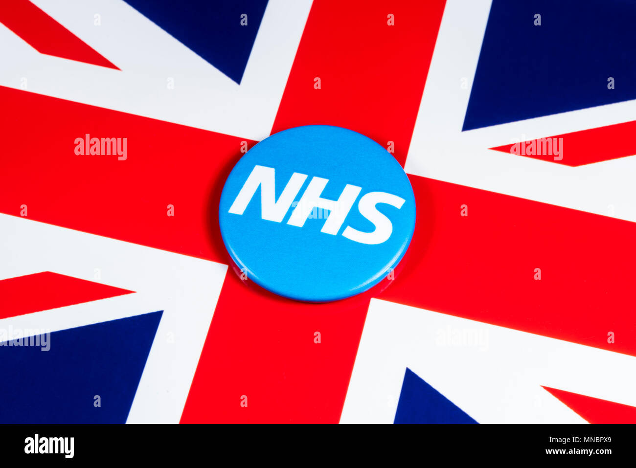 LONDON, UK - APRIL 27TH 2018: The National Health Service symbol over the UK flag, on 27th April 2018.  The NHS was established in 1948 as one of the  - Stock Image