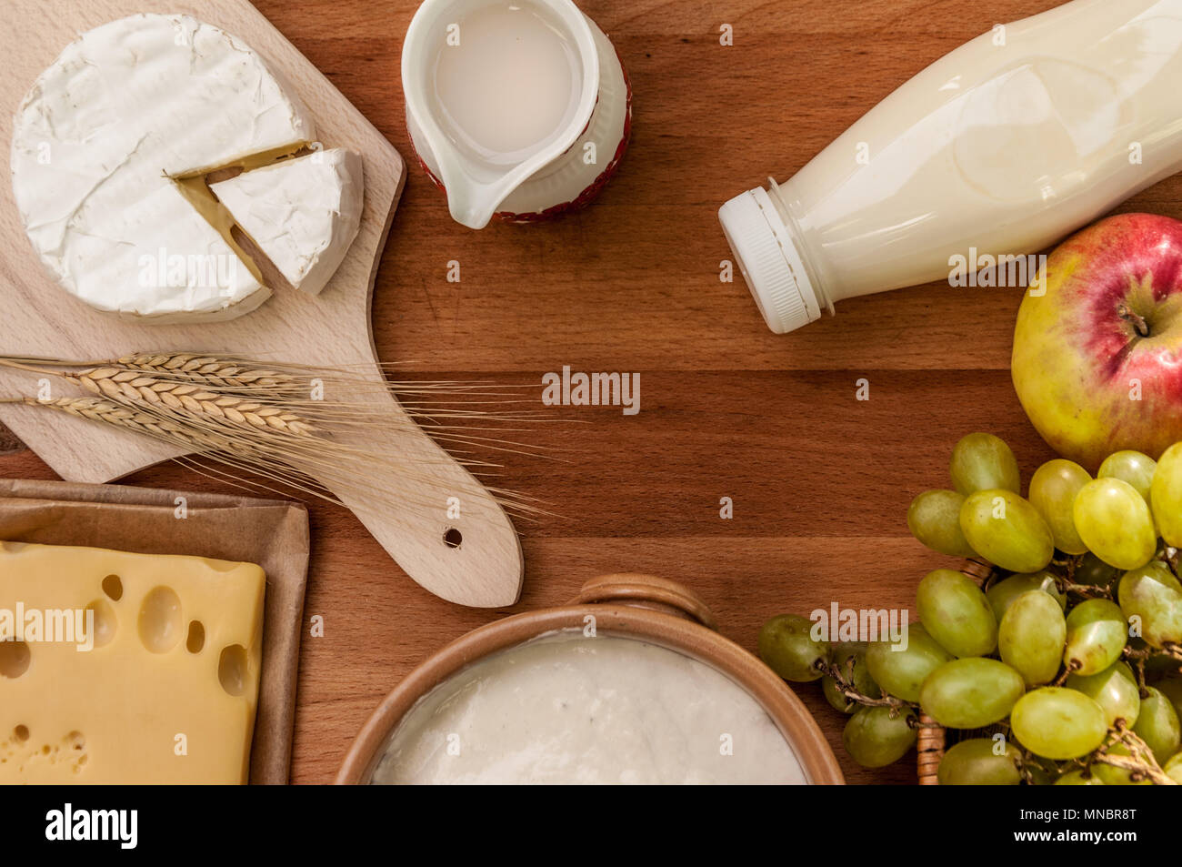 Rustic style tabletop with fruits and dairy products for shavuot celebration - Stock Image