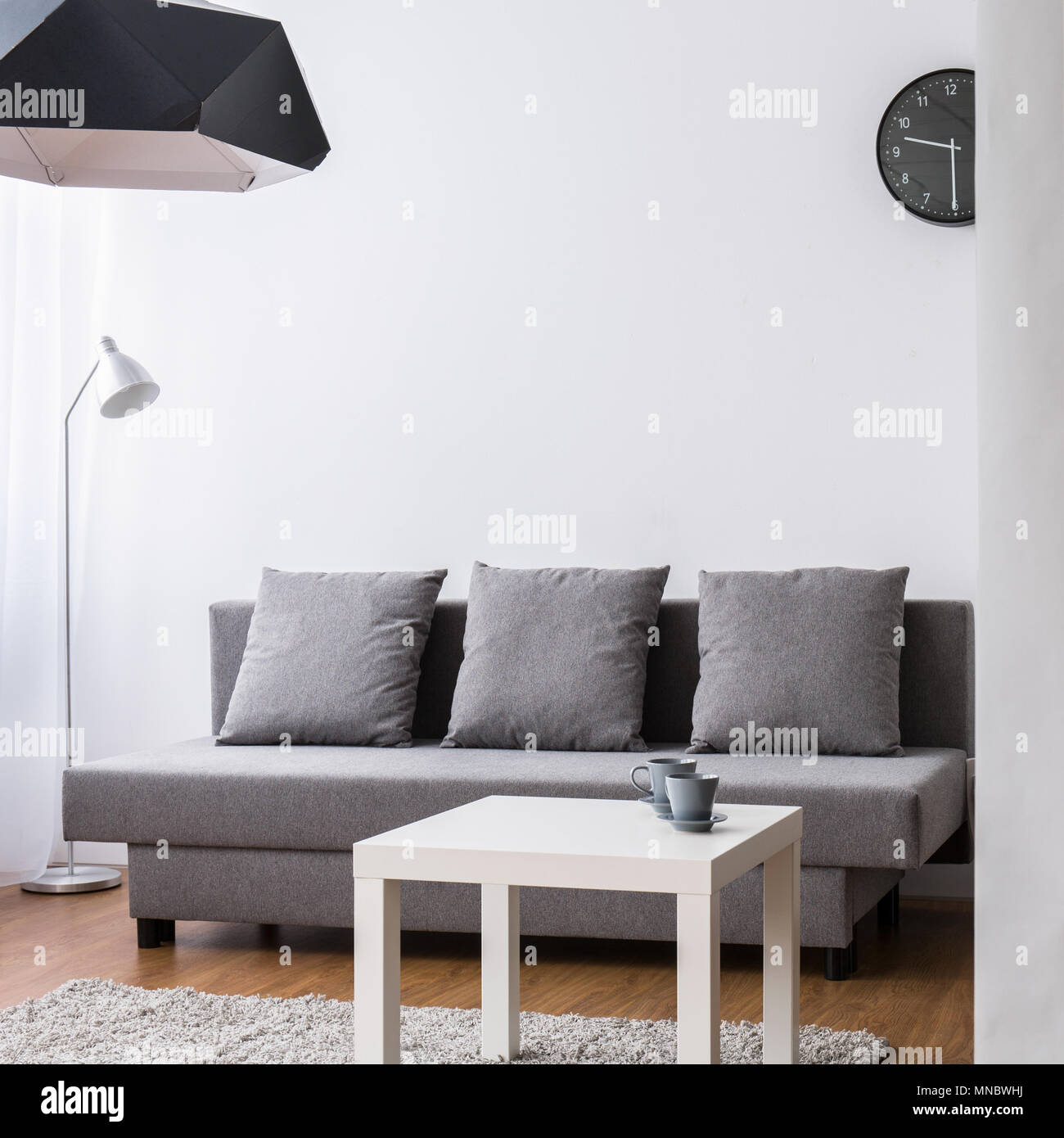 Modern Living Room With Large Grey Sofa And Small Coffee