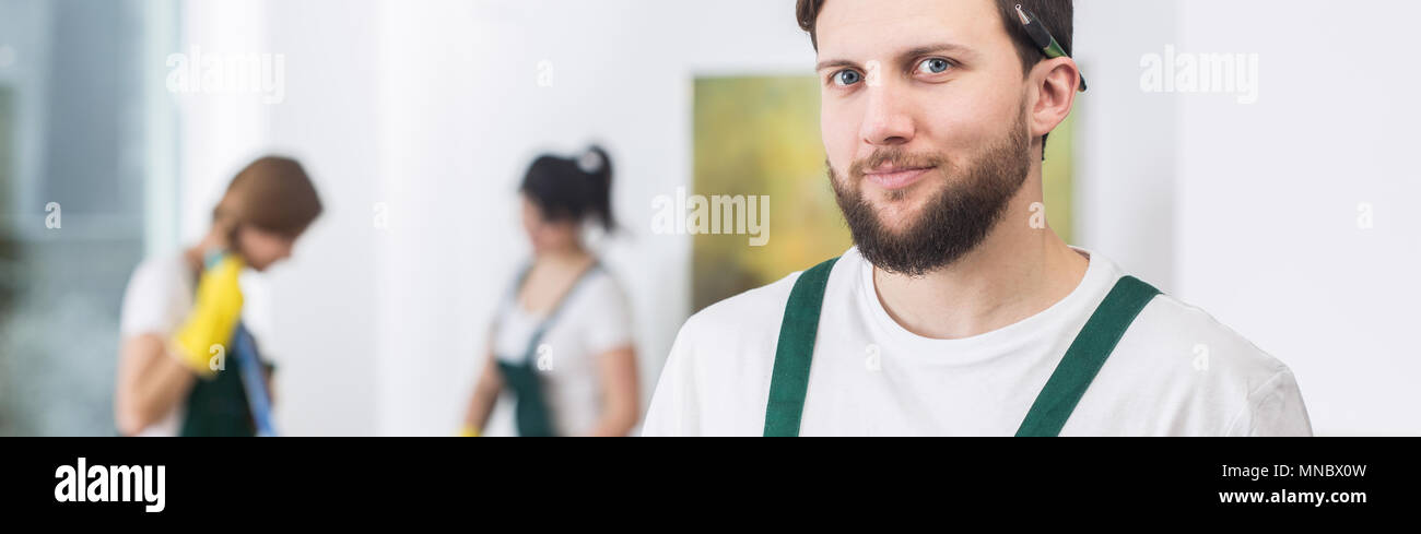 Young professional cleaner is very neat and tidy - Stock Image