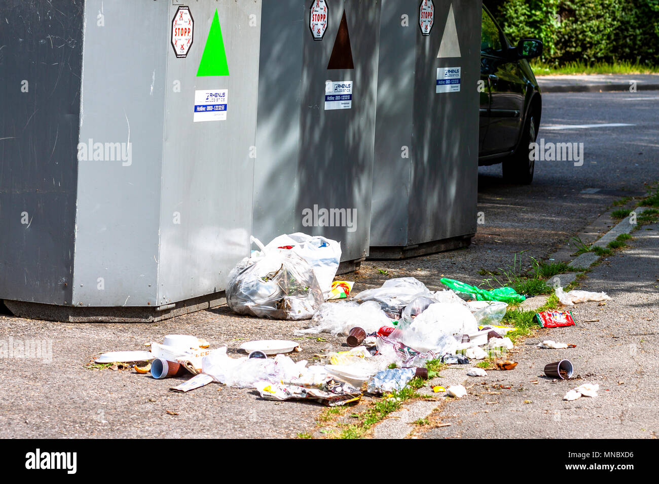 ESSEN / GERMANY - MAY 12 2018 : Rubbish is lying next to the bin - Stock Image