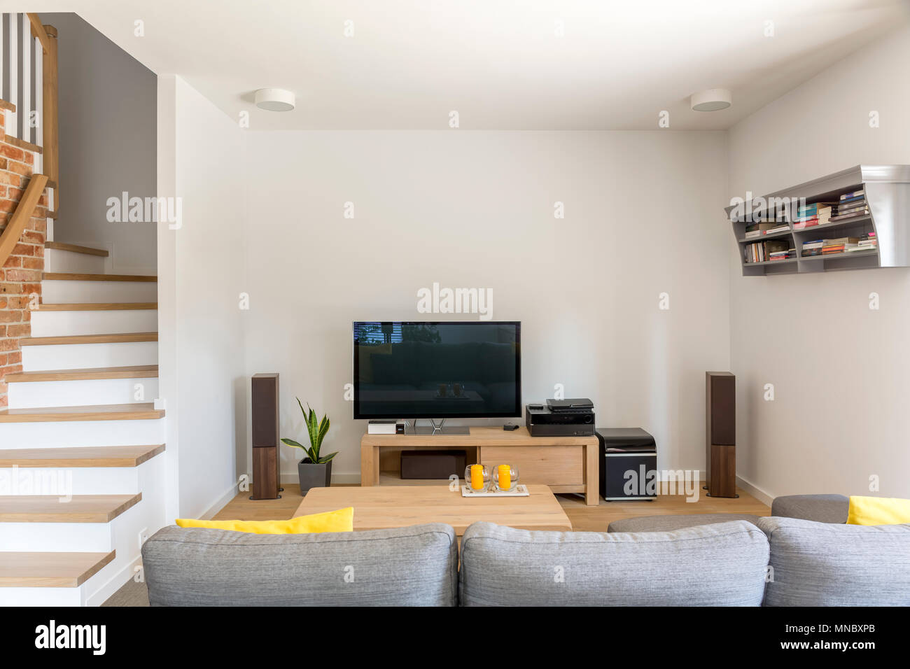 Open Living Room With Tv Sofa And Staircase Stock Photo Alamy