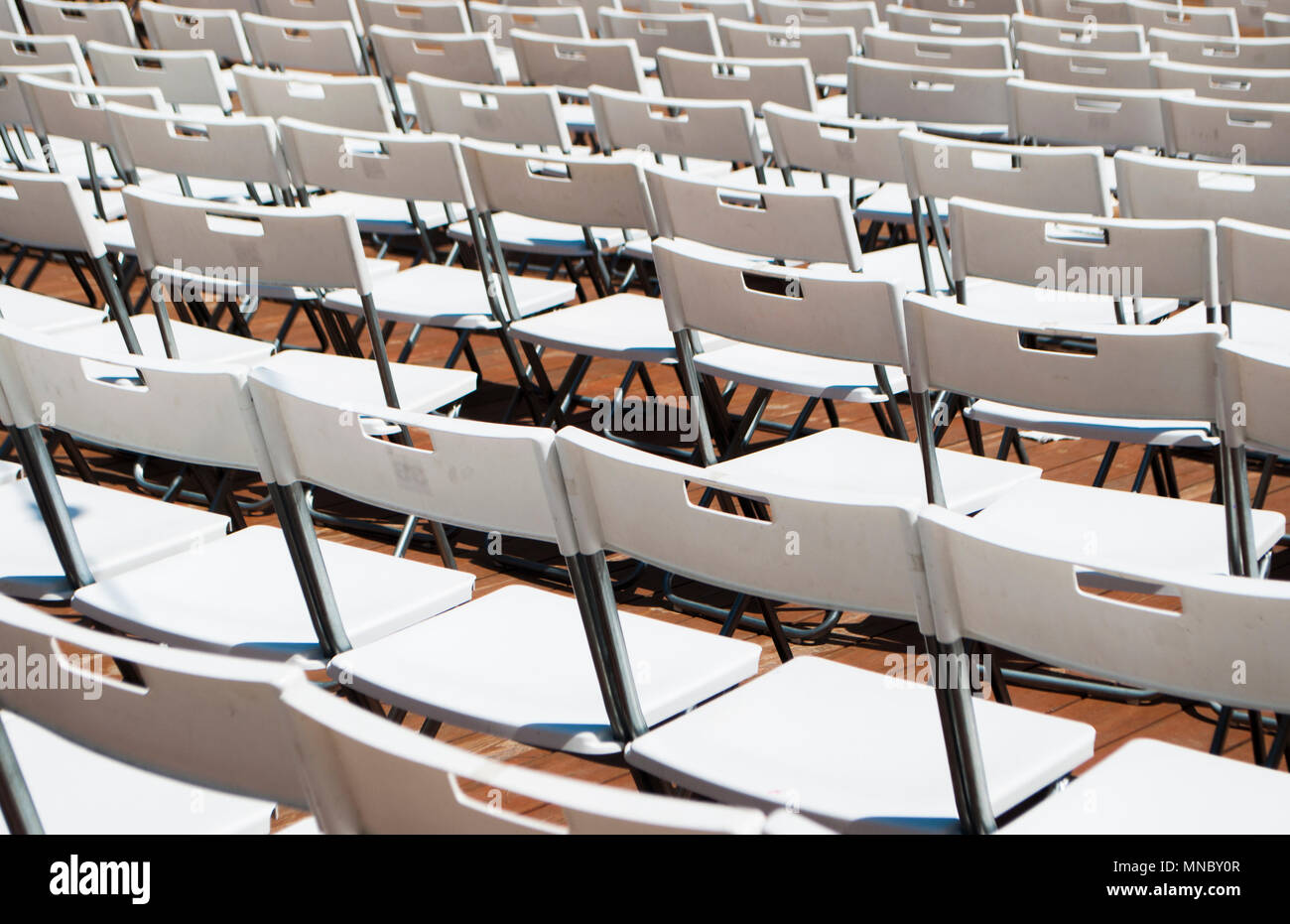 Awe Inspiring Rows Of White Empty Folding Chairs In A Summer Theatre Stock Caraccident5 Cool Chair Designs And Ideas Caraccident5Info