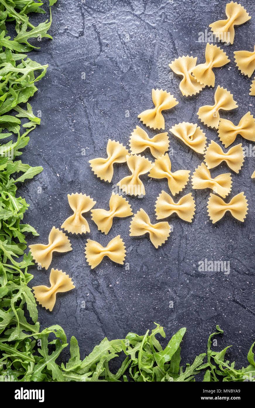 Food background Uncooked Pasta Macaroni Farfalle - Stock Image