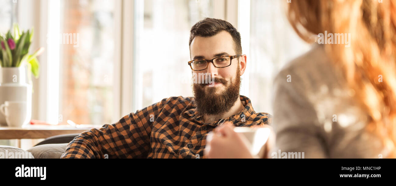 Panorama of happy hipster man looking at his wife Stock Photo