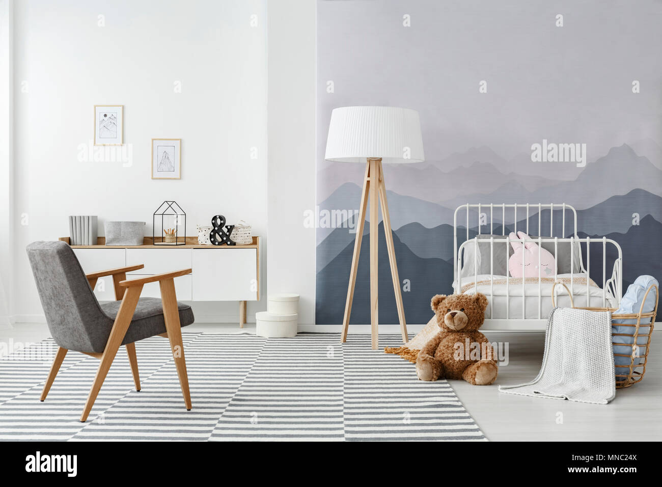 A Wooden Floor Lamp And A Modern Gray Armchair In A Monochromatic Childu0027s  Bedroom Interior In Scandinavian Style
