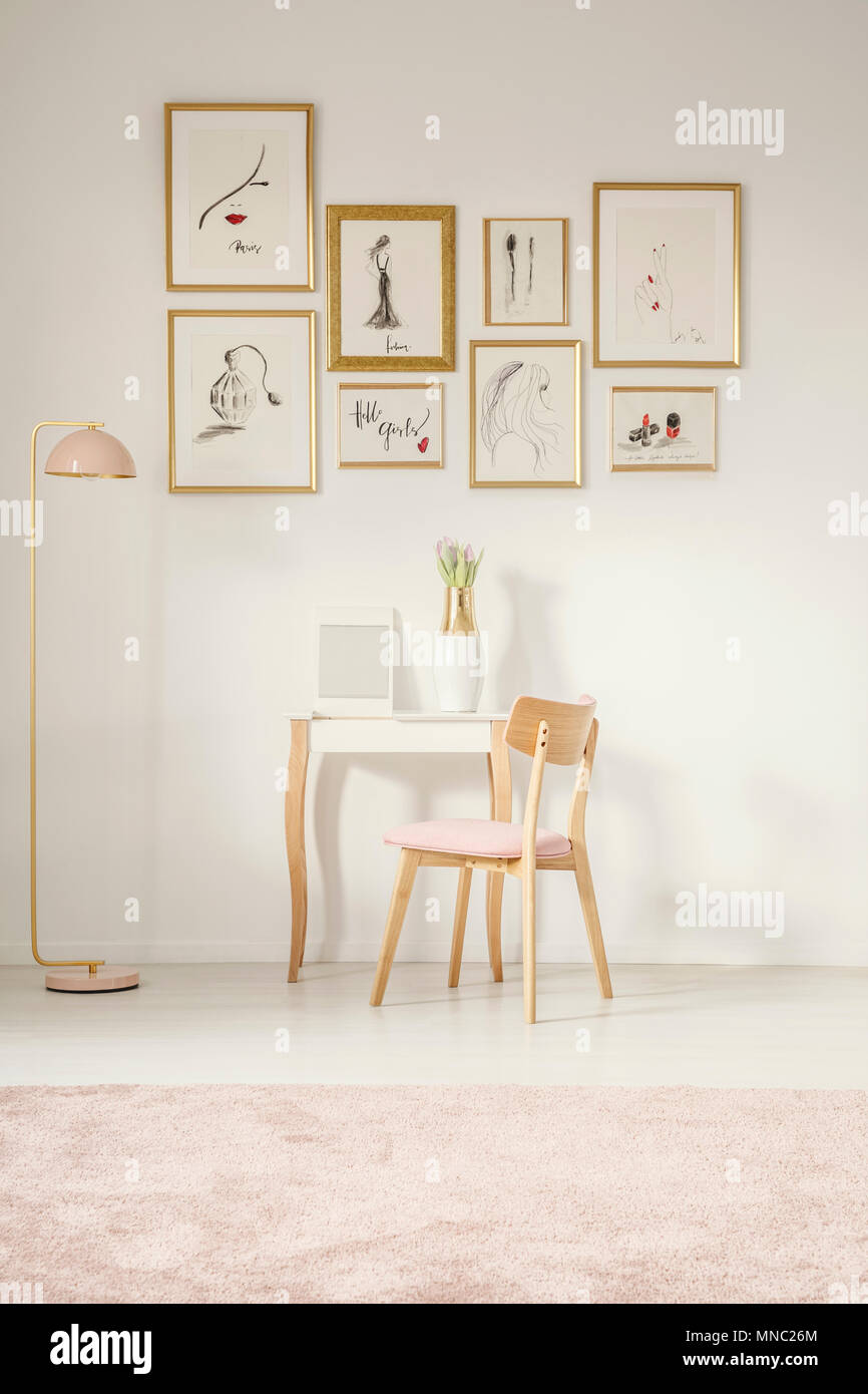 Wooden Pink Chair At Dressing Table Next To Gold Lamp In Feminine Flat  Interior With Gallery Of Posters