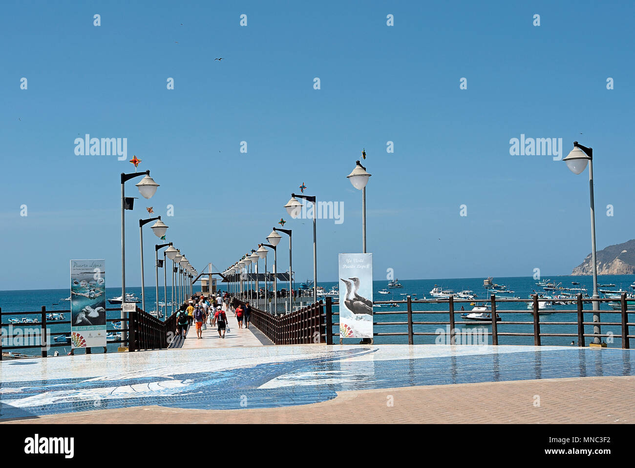 Dock with people ready to embark - Stock Image