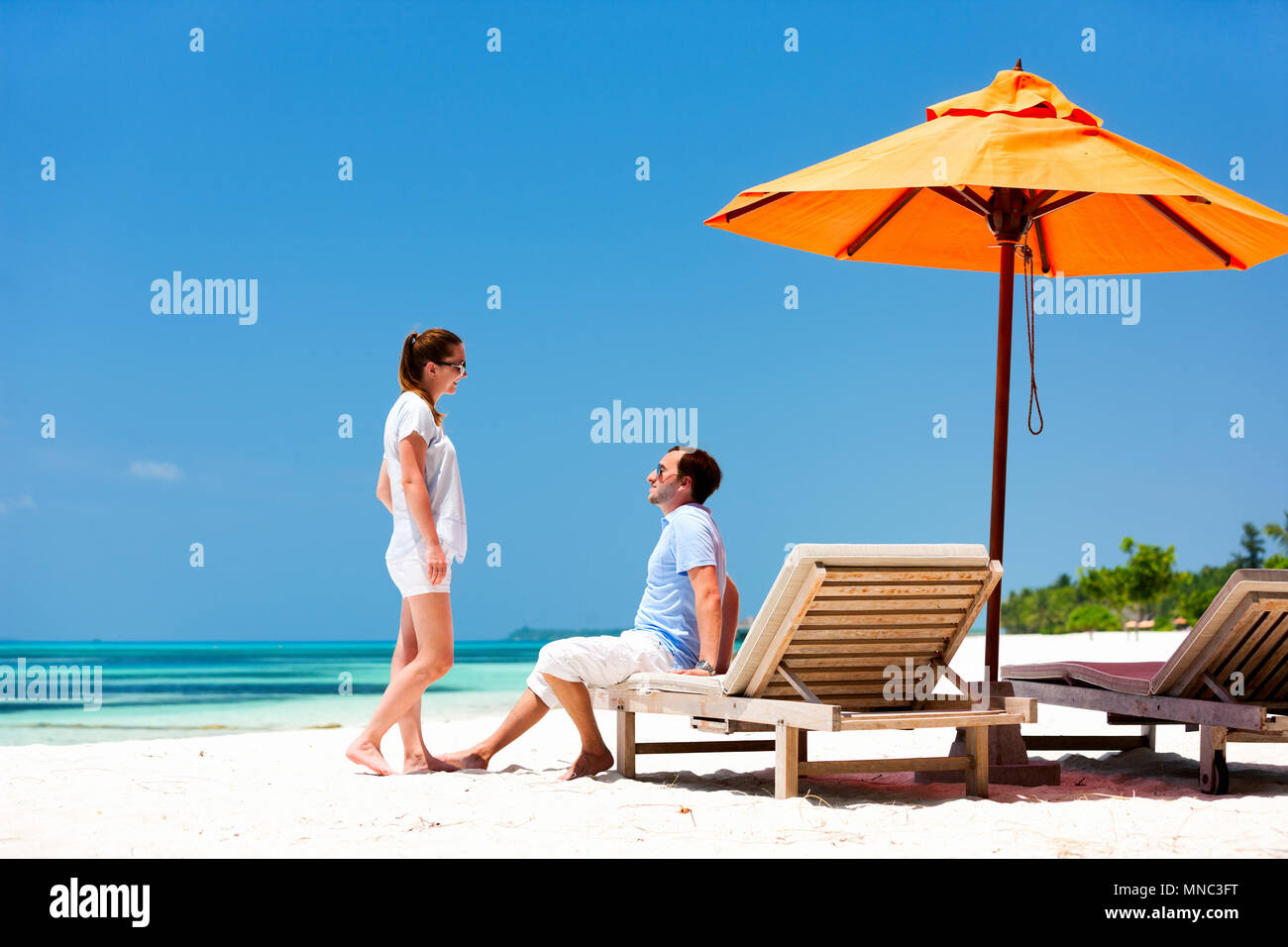 Romantic couple on a tropical beach during honeymoon vacation - Stock Image