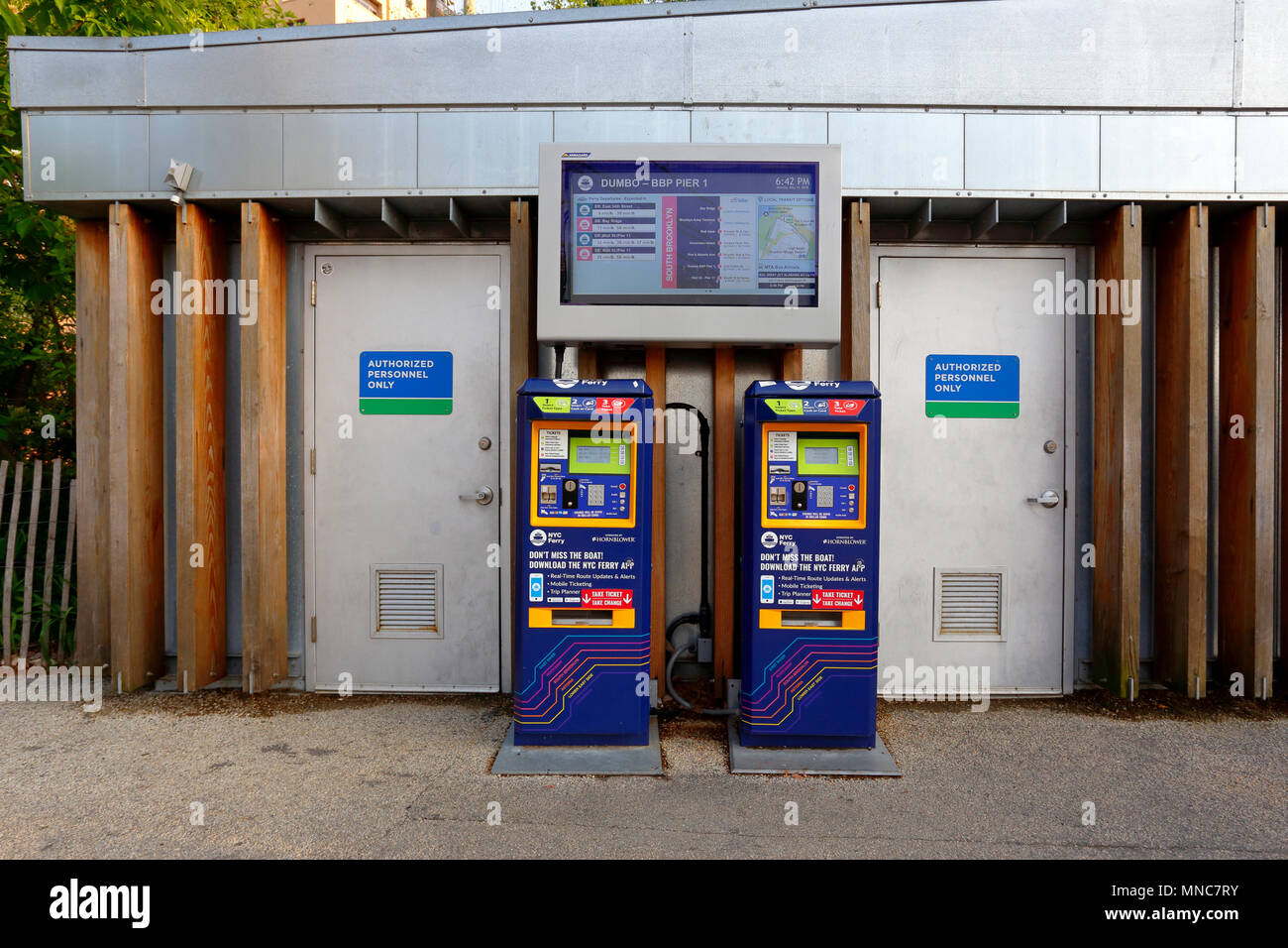 NYC Ferry ticket machines, and departure board - Stock Image