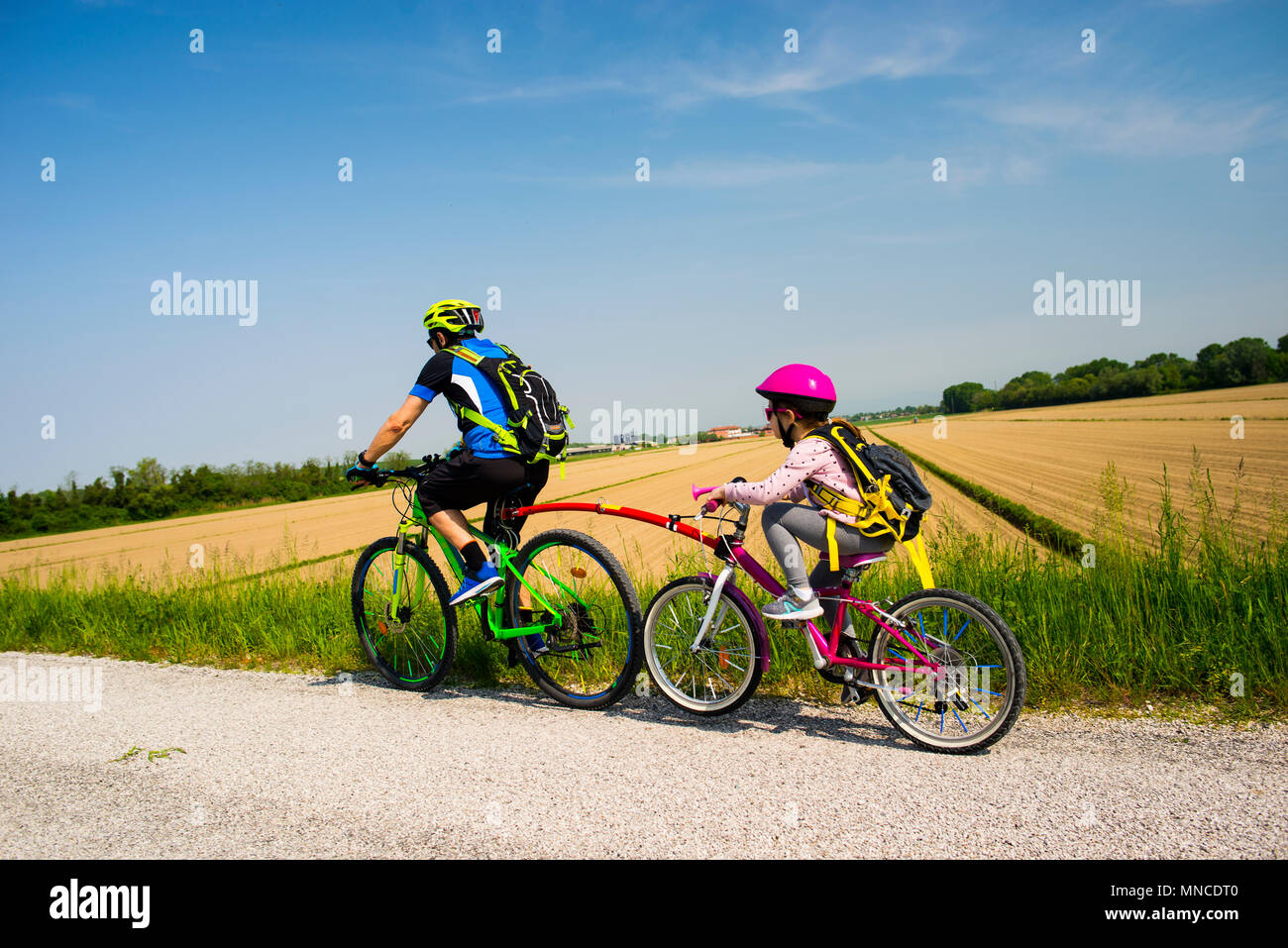 Father and daughter going in bicycle - Stock Image