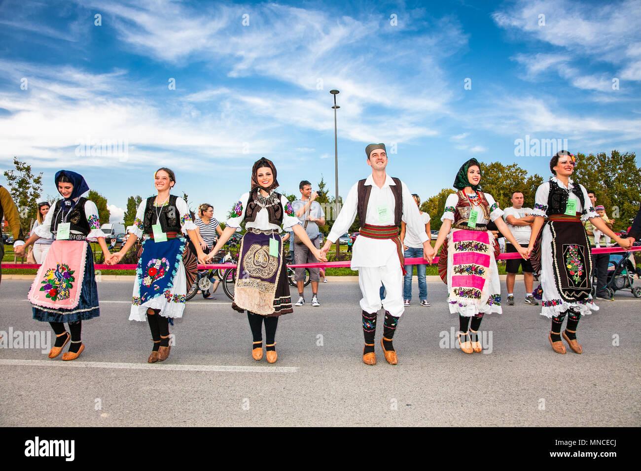 NOVI SAD, SERBIA-OCT 4, 2015: Guinness World Record Largest Folk Dance on Oct 4. 2015 in Novi Sad, Serbia. Over 12.000 participants break the Guinness Stock Photo