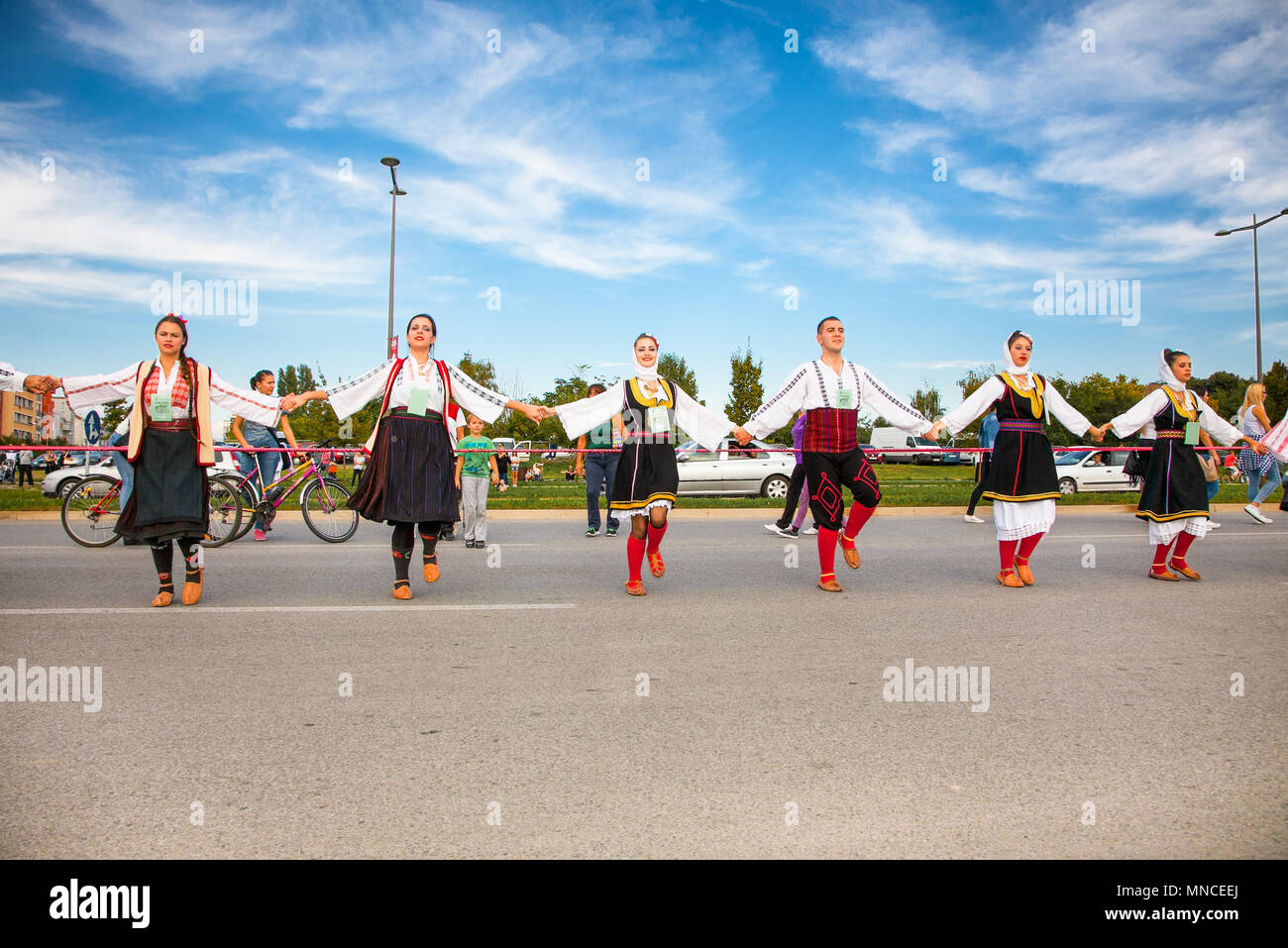 NOVI SAD, SERBIA-OCT 4, 2015: Guinness World Record Largest Folk Dance on Oct 4. 2015 in Novi Sad, Serbia. Over 12.000 participants break the Guinness Stock Photo