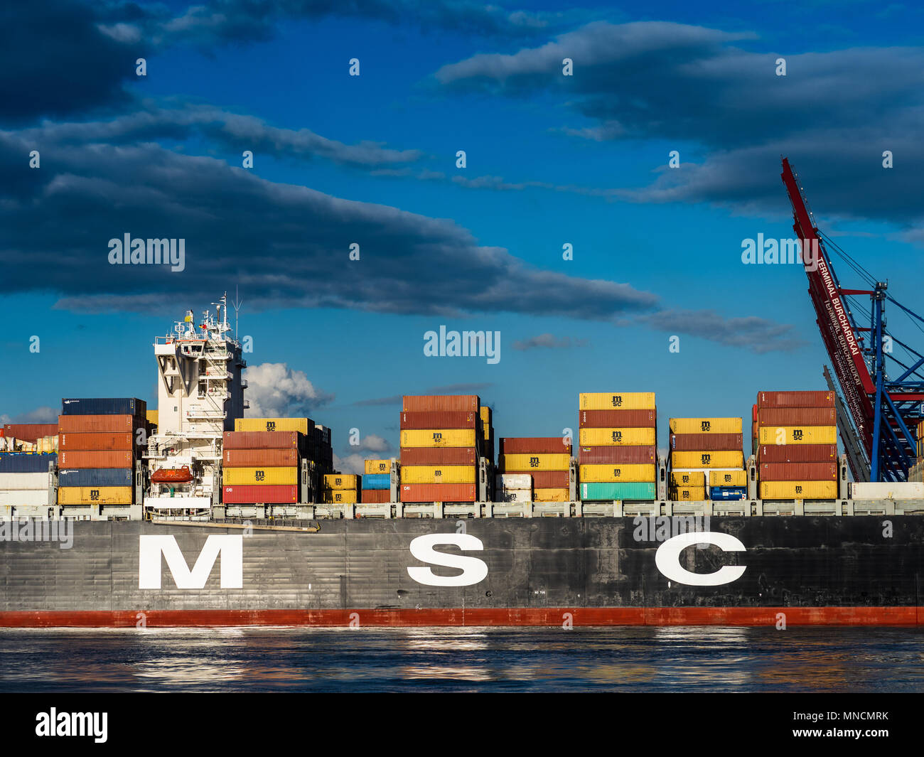 Global Trade World Trade International Trade - containers arrive in Hamburg Port, one of Europe's largest ports on MSC Topaz - Stock Image