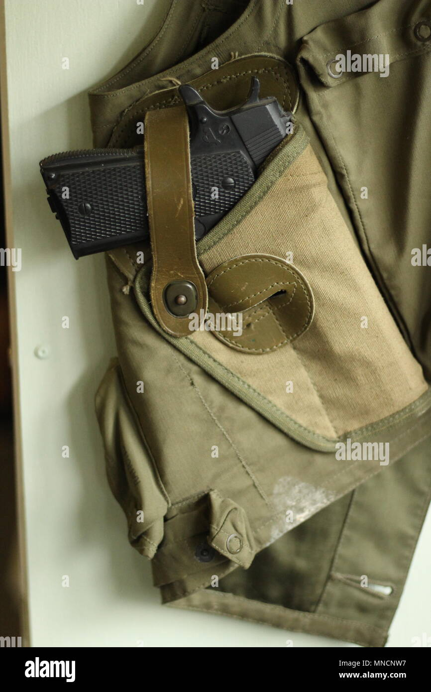 Images of WW2 - Textiles - Military Clothing. Side shot of a holstered pistol strapped in a flak jacket. B17 aircrew. - Stock Image