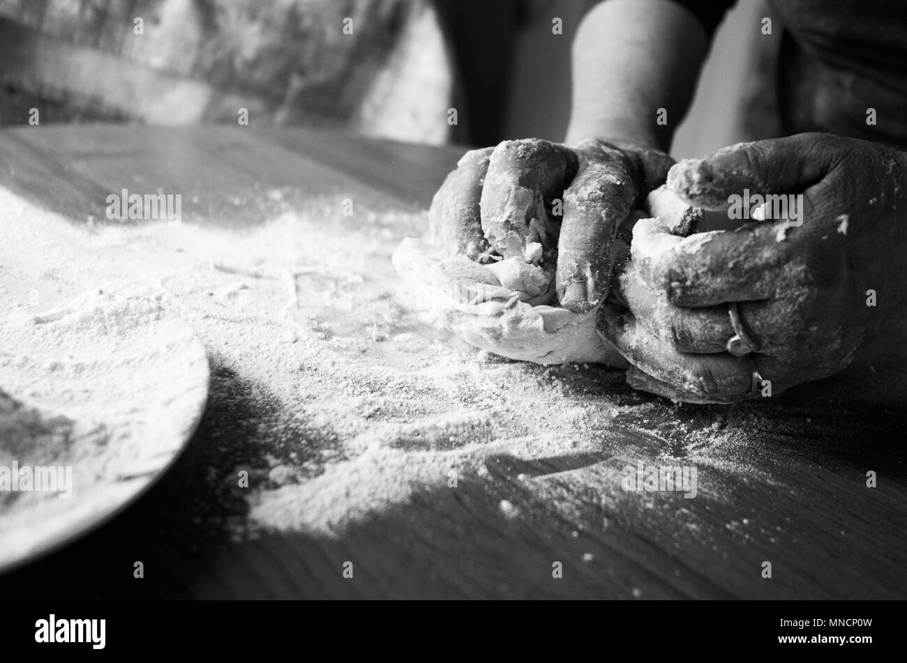 Kneading dough - Stock Image