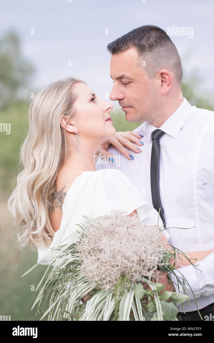 lovers, young couple. Beautiful people, in love with each other and looking into each other's eyes. outdoor session. boho. newlyweds. - Stock Image