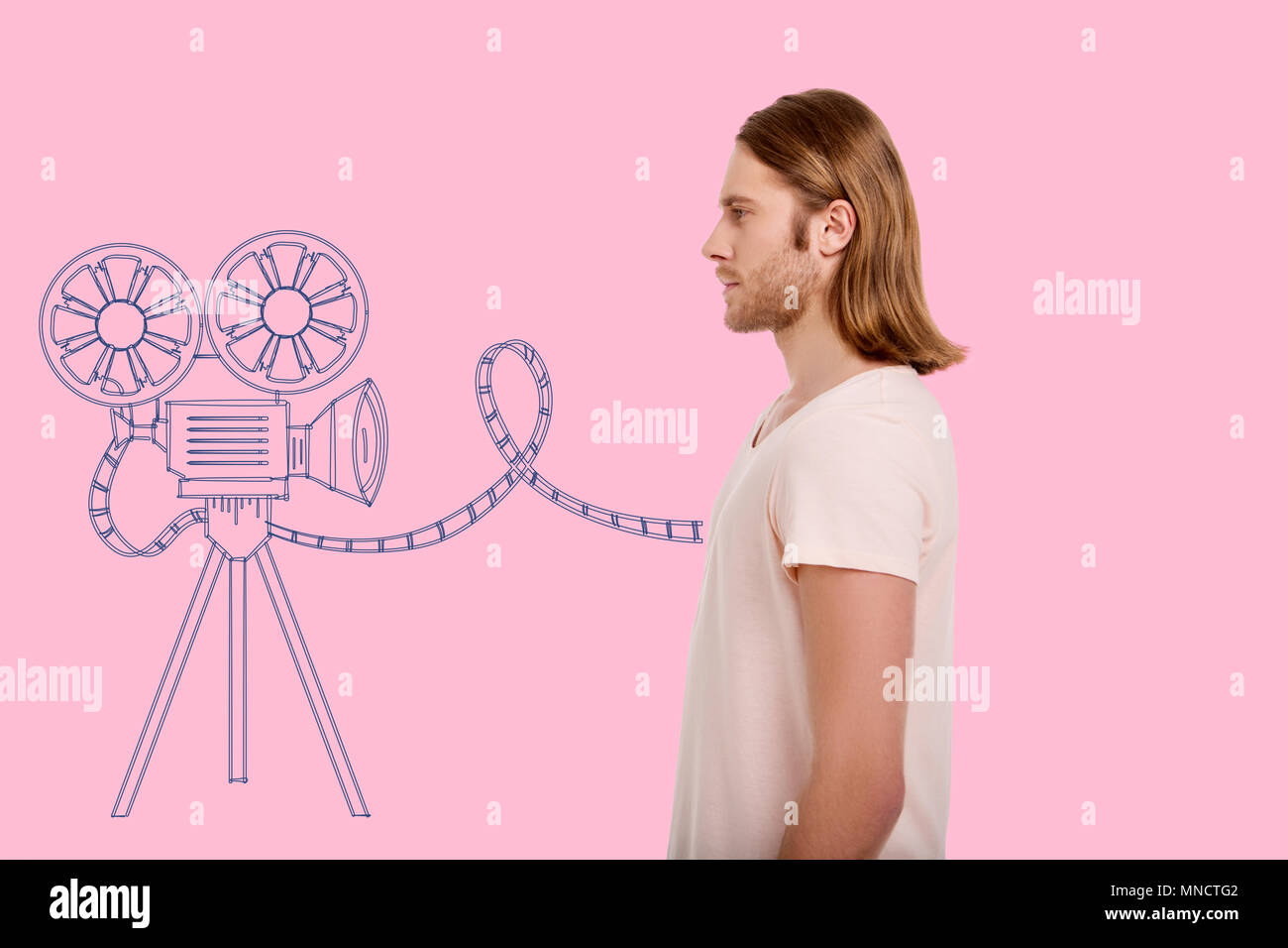 Profile of good looking man being keen on cinematography - Stock Image