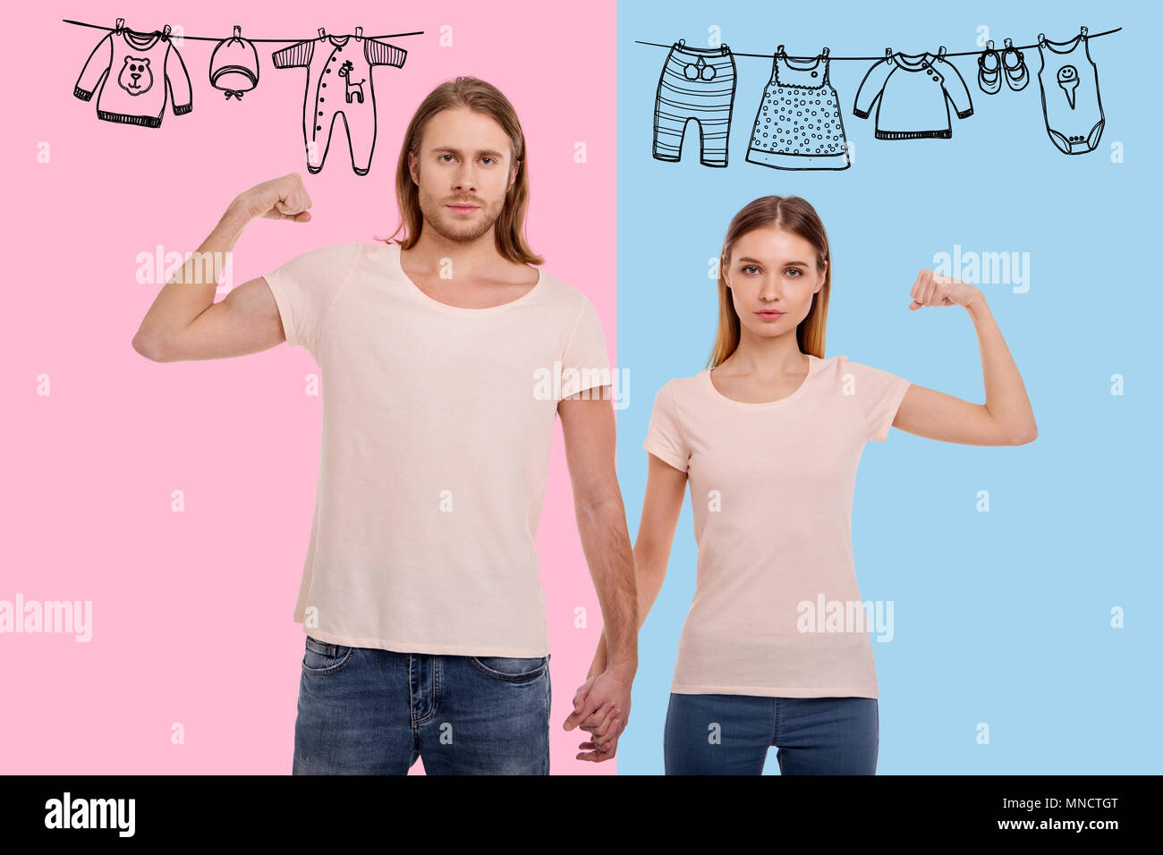 Waist up of pleasant family showing their muscles - Stock Image