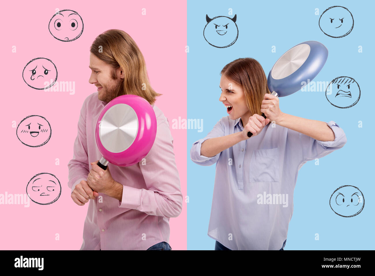 Close up of jealous girl threatening her boyfriend with a frying pan - Stock Image